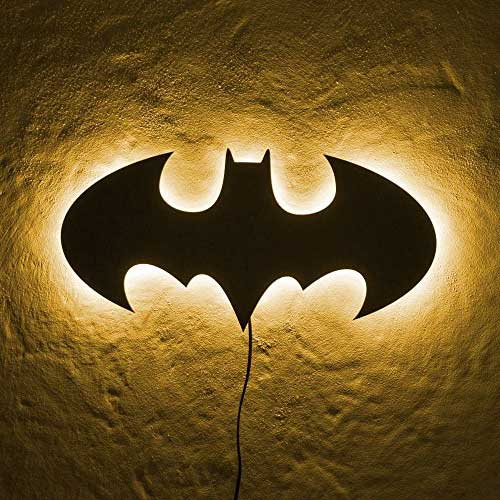 Batman LED Wall Light in yellow light hung on wall