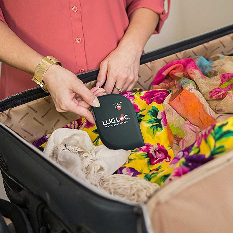 Luggage-Tracking-Device being put into a suitcase