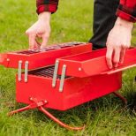 Toolbox-Barbeque-Grill being opened and set up in a park