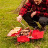 Toolbox-Barbeque-Grill being used to grill meats in a park