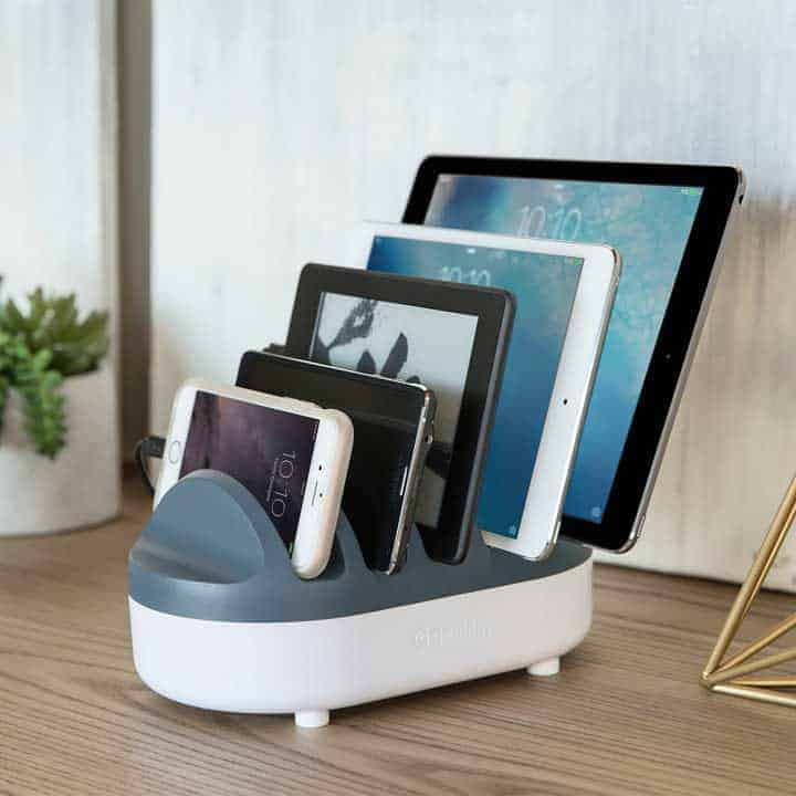 usb-charging-station with five devices on a table