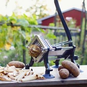 French-Fry-Cutter cutting potato fries