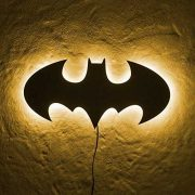 Batman LED Wall Light in yellow light hung on wall