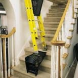 Ladder-Leveling-Tool being used on stairway